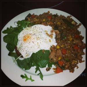 Poached egg and brown fried rice